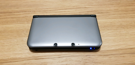 Nintendo 3DS XL with game and accessories